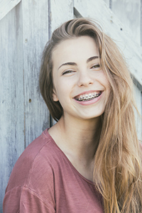 A smiling teen girl with braces in Sherman Oaks, CA.