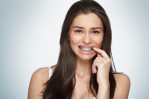 Woman with braces at Dougherty Orthodontics